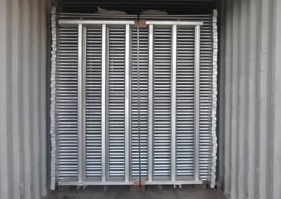 a pallet galvanized fence panel packed with steel plate on container