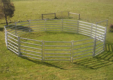 13 galvanized fence panels and gate makes round pen at pasture
